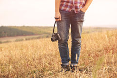 Young Man with retro photo camera outdoor hipster Lifestyle Royalty Free Stock Photos