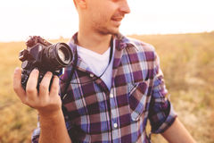 Young Man with retro photo camera outdoor hipster Lifestyle. Film effect Stock Photography