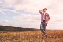 Young Man with retro photo camera outdoor hipster Lifestyle. Film effect Stock Images