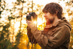 Young Man with retro photo camera outdoor Royalty Free Stock Photos