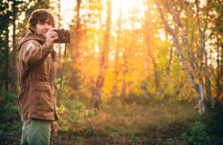 Young Man with retro photo camera outdoor Stock Photo