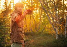 Young Man with retro photo camera outdoor Lifestyle Royalty Free Stock Images