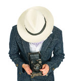 Young man in a retro style with a camera Stock Image