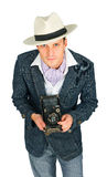 Young man in a retro style with a camera Royalty Free Stock Image