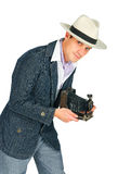 Young man in a retro style with a camera Royalty Free Stock Photos