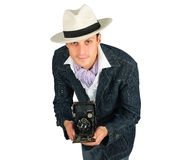 Young man in a retro style with a camera Stock Images
