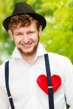 Young man retro style with red heart on chest Stock Photography