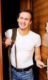 Young man returning home from work or trip Stock Images