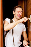 Young man returning home from work or trip Stock Image