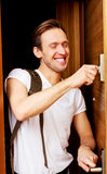 Young man returning home from work or trip Royalty Free Stock Photos
