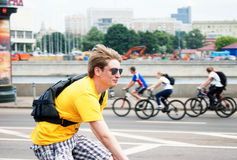 Young man rides a bike Stock Images
