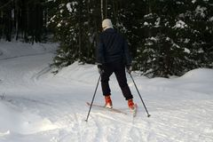 A young man rides cross-country skiing. Active winter. Active guests. Amateur sports. A young man rides cross-country skiing. Active winter. Active guests stock images