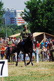 Young man rides a horse. Horse riders competition Stock Images