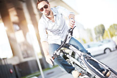 Young man riding a bicycle Royalty Free Stock Images