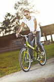 Young man riding bicycle Stock Photography