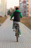 Young man riding a bicycle Stock Photo