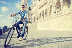 Young man riding bicycle in Budapest, Hungary Stock Photos