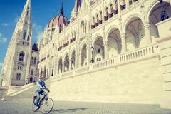 Young man riding bicycle in Budapest, Hungary Royalty Free Stock Photos