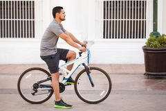 Young man riding a bicycle in the city Royalty Free Stock Photos