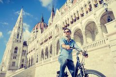 Young man riding bicycle in Budapest, Hungary Royalty Free Stock Photography