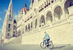 Young man riding bicycle in Budapest, Hungary Royalty Free Stock Photo