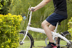 Young man riding on the bicycle on the pathway. Stock Photography