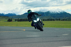 Young man riding big bike motorcycle on asphalt highways use for Stock Photography