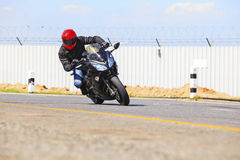 Young man riding big bike motorcycle on sharp curve asphalt road. Use for biker activity and rider traveling topic Royalty Free Stock Photography