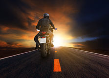 Young man riding big motorcycle on asphalt highway use for peopl Royalty Free Stock Images