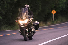 Young man riding big motorcycly on asphalt road use Royalty Free Stock Photos
