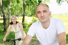 Young man riding a bike Stock Photos
