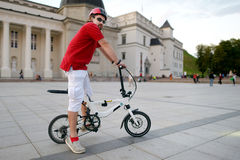 Young man riding a bike Stock Photography