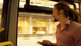 A young man riding a bus stock video