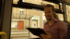 A young man riding a bus stock footage