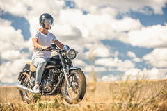 Young man riding his motorbike on open road Royalty Free Stock Photography