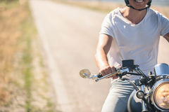 Young man riding his motorbike on open road Stock Image