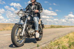 Young man riding his motorbike on open road Stock Photo