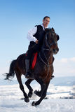 Young man riding horse outdoor Royalty Free Stock Images