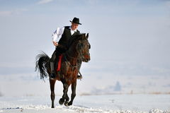 Young man riding horse outdoor in winter. Day Stock Images