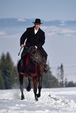 Young man riding horse outdoor in winter Stock Photo