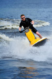 Young man riding jet ski Stock Photo