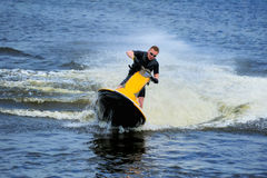 Young man riding jet ski Stock Photography