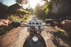 Young man riding on a motorcycle Stock Images