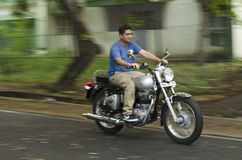 Young man riding a motorcycle Royalty Free Stock Image