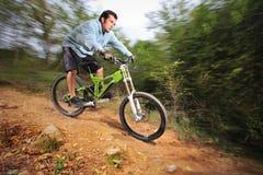 A young man riding a mountain bike Stock Photography