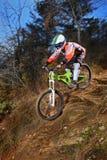 A young man riding a mountain bike. Downhill style Stock Photos