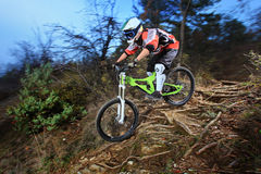 A young man riding a mountain bike. Downhill style Royalty Free Stock Images