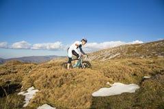 Young man riding a mountain bike Stock Image