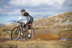 Young man riding a mountain bike Royalty Free Stock Image