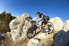 Young man riding a mountain bike Royalty Free Stock Photos